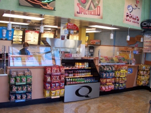 Interior of a Quizno's. Complete lack of visibility of product on the left side hurt the chain due to it alienating customers through a lack of trust.