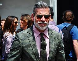 Nick Wooster: #menswear cult leader, fashion blog photo whore, and fashion clown. Tries way too hard to look good. GQ loves him.