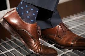 When in a professional setting, match your socks' colour to the colour of your pants.