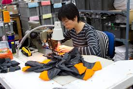 A Chinese worker making an Arc'Teryx Jacket