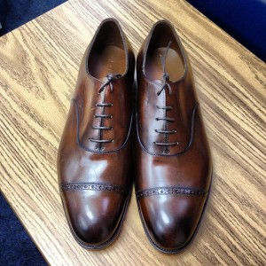 A pair of Edward Green shoes. They will set you back almost a grand, but the finish on the leather and the quality of the construction will outshine and outlast 3 or 4 pairs of cheaper shoes.