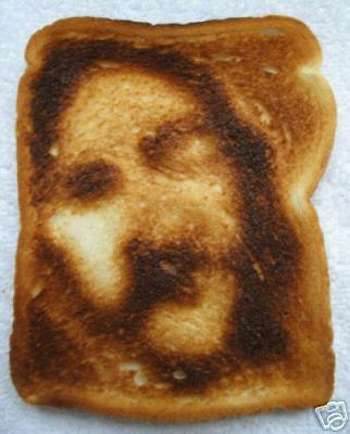 Seeing the face of Christ on this piece of burnt toast is an example of